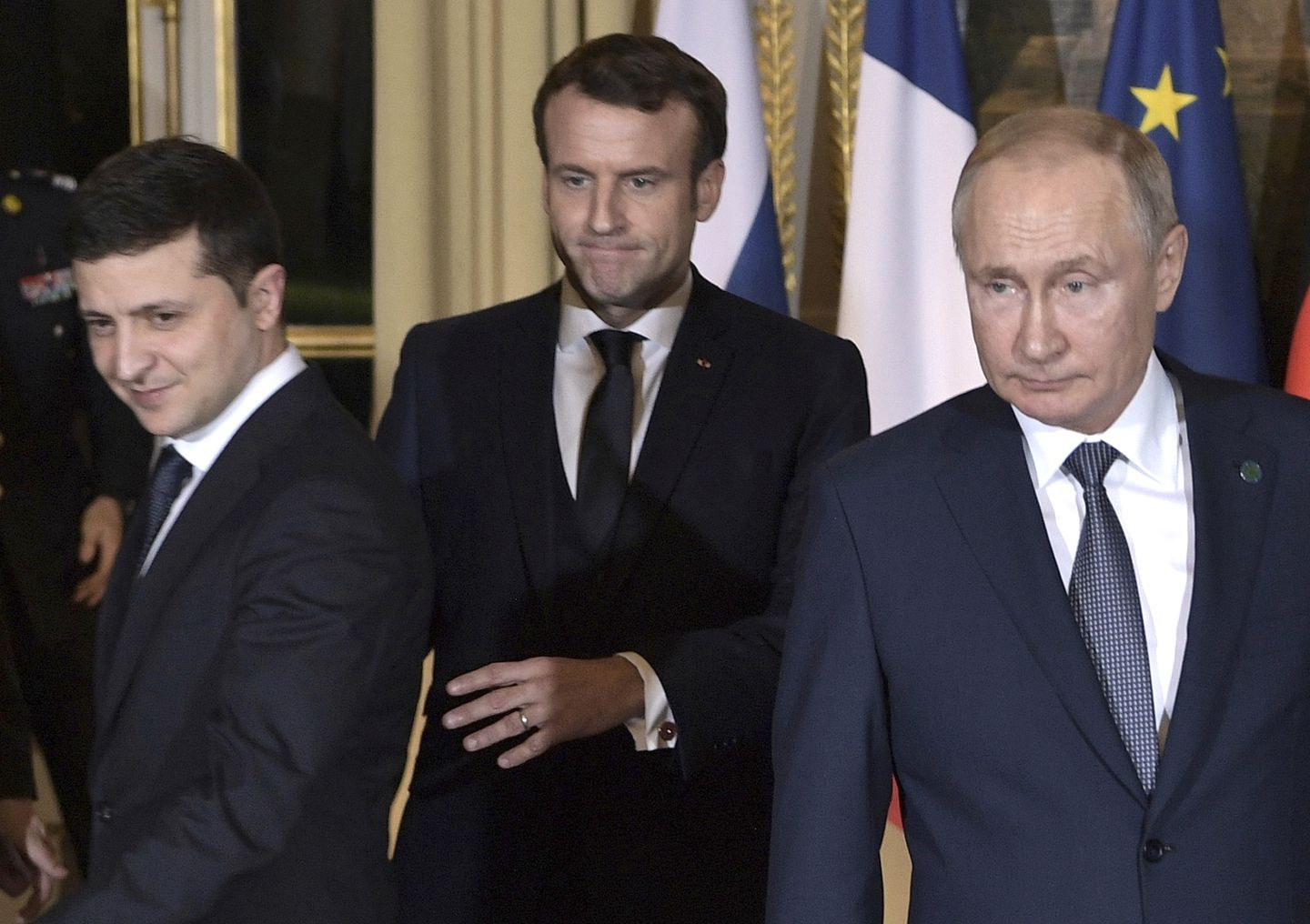 Ukrainian President Volodymyr Zelensky (left), French President Emmanuel Macron (center), and Russian President Vladimir Putin arrived Monday for a working session at the Elysee Palace in Paris.