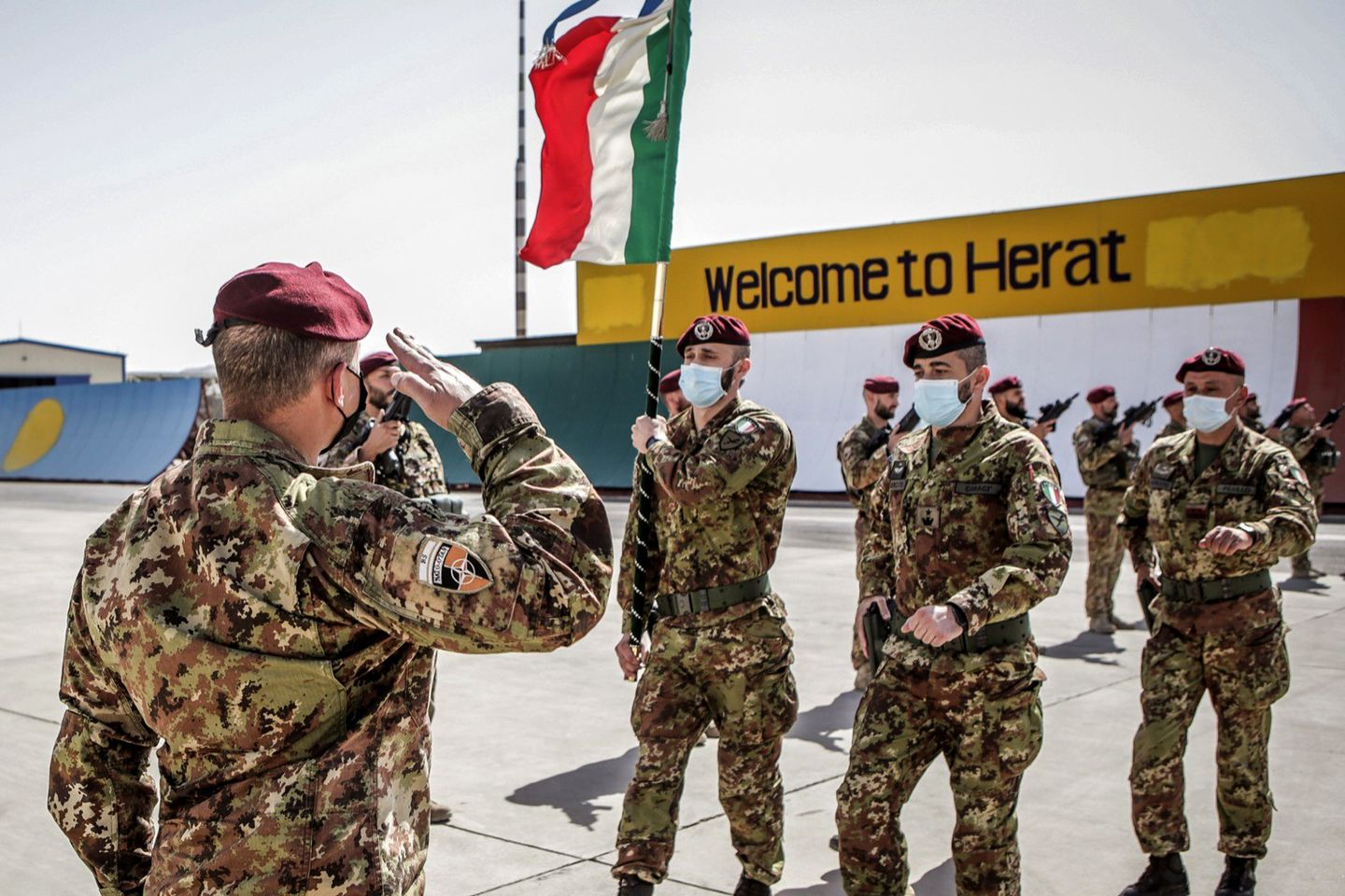 Italian Army soldiers carried the flag of the Folgore Brigade as the last Italian troops withdrew from Afghanistan.