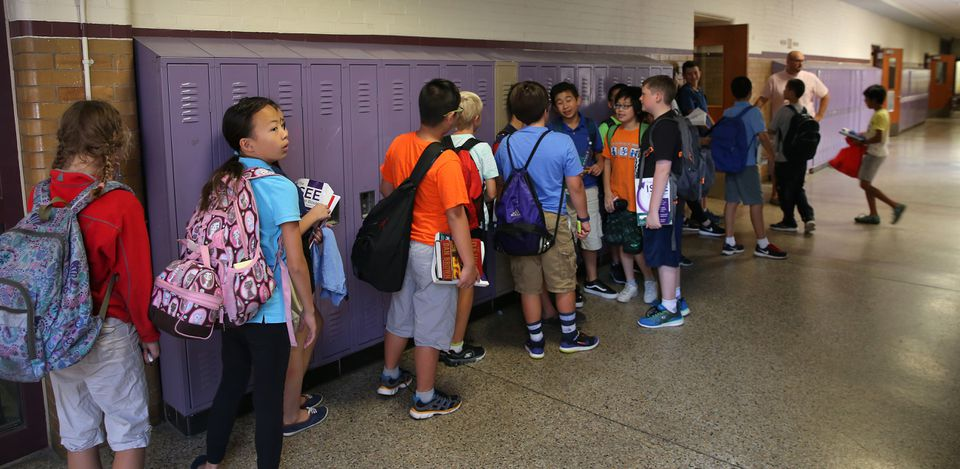 Students lined up in the hallway at Boston Latin School to switch classrooms during a break last week.