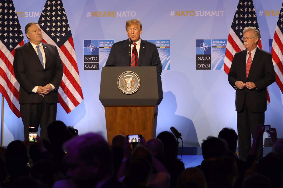 President Donald Trump, center, speaks flanked by Mike Pompeo, US secretary of state, left, and John Bolton, US national security advisor, during a news conference at the North Atlantic Treaty Organization (NATO) summit in Brussels on Thursday.