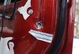 A bullet hole on the inside of the passenger door on the vehicle where Alan Greenough hid. He was shot while exiting through the passenger side door.