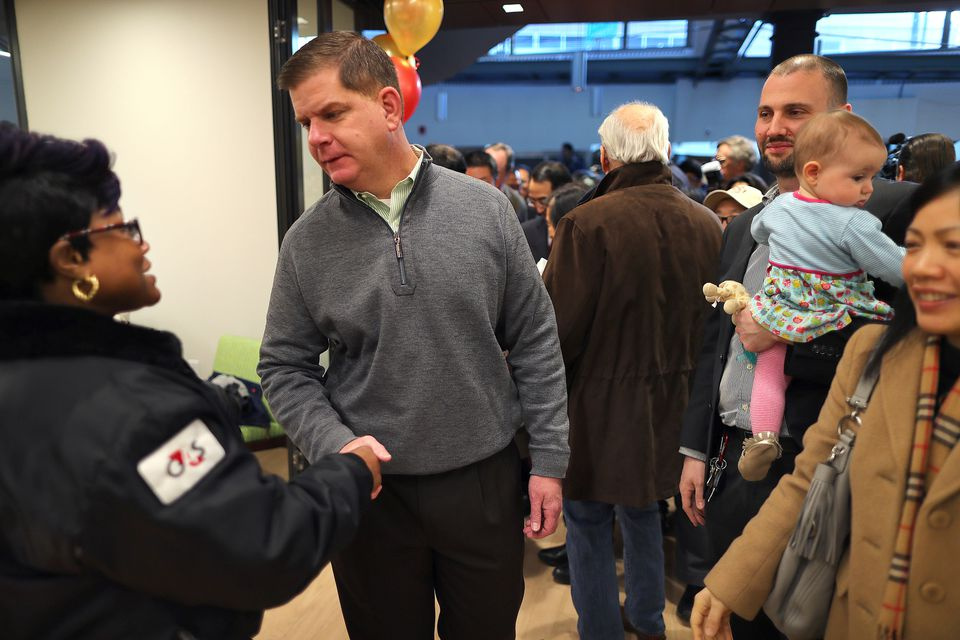Mayor Martin J. Walsh greeted workers at a new Boston Public Library temporary space inside the Chinatown Trade Center.