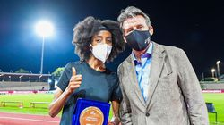 Sebastian Coe (right), here posing with runner Sifan Hassan this month, is trying to funnel more money to the athletes in his role as World Athletics president.