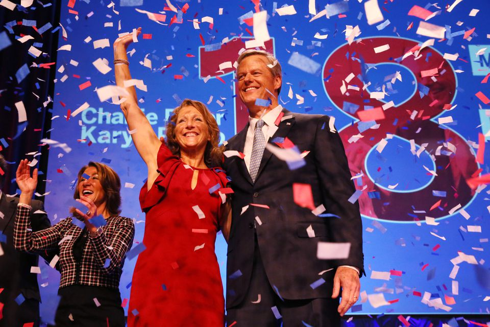 Governor Charlie Baker and his wife Lauren celebrated with Lieutenant Governor Karyn Polito, left, during an election night rally on Nov. 6, 2018.