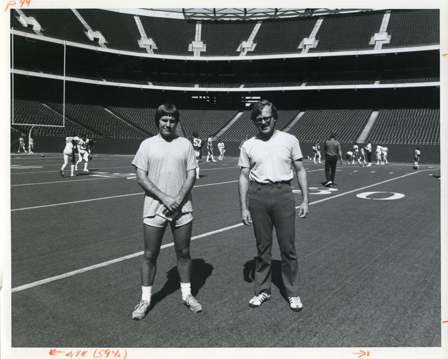 Bill Belichick (left) and Ernie Adams (right).