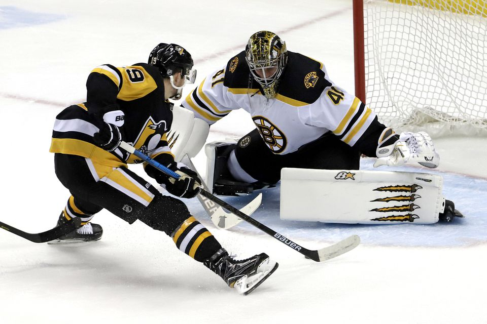 Penguins forward Jared McCann (19) skated in on Bruins goalie Jaroslav Halak for a shorthanded goal in the first period of Sunday's game in Pittsburgh.