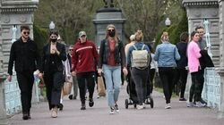 Some people wore masks in the Public Garden and some did not on April 30 after Governor Baker eased the outdoor mask mandate.