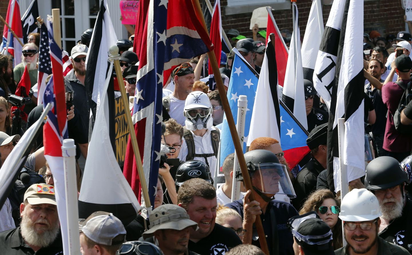 White nationalist demonstrators walked into the entrance of Lee Park surrounded by counter-demonstrators in Charlottesville, Va., on Aug. 12.