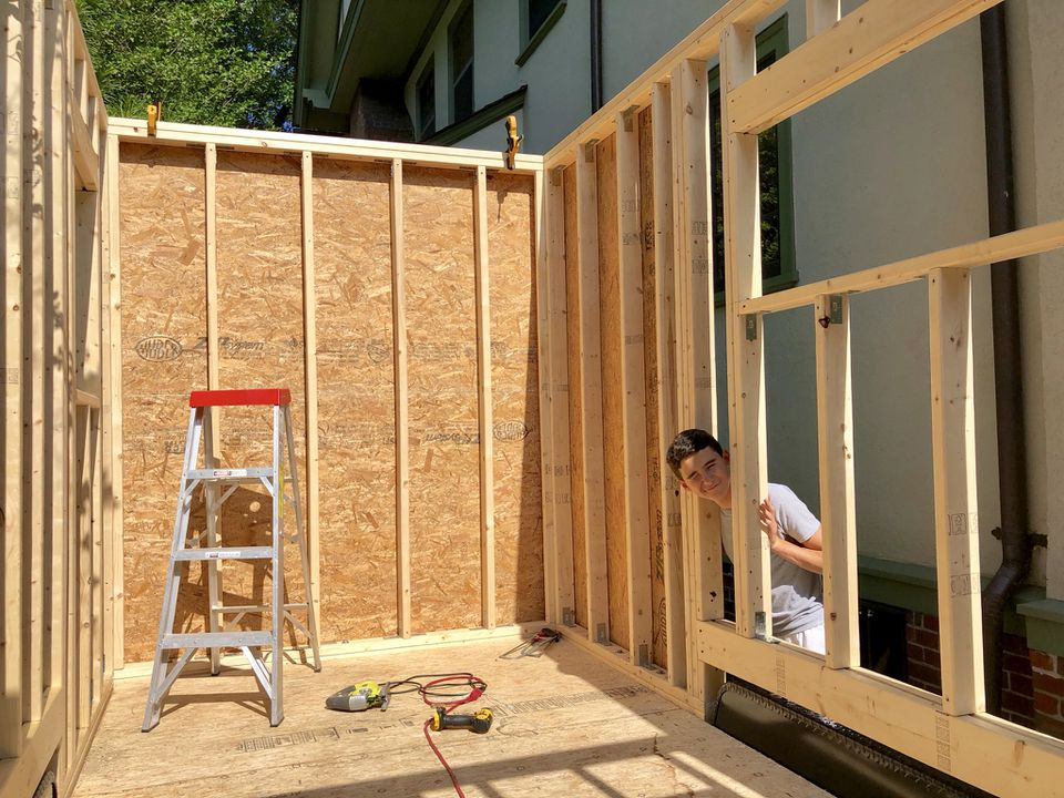 Duncan Jurayj, 16, is building a tiny house on top of a trailer in his Brookline driveway after receiving a $5,000 grant from his high school, Beaver Country Day School in Chestnut Hill.