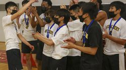 Jonathan Lee (left), hoisting the hardware for his teammates, was named MVP of the City League championship.