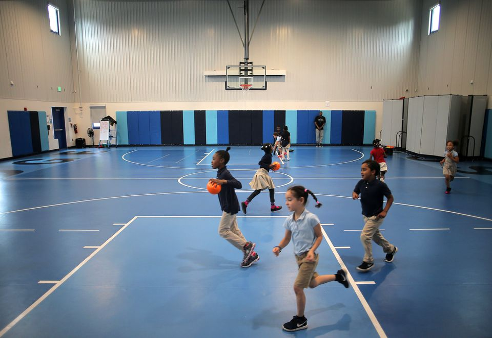 Students released some energy with a romp through a new gym, which Bridge Boston Charter School built at a converted office building.