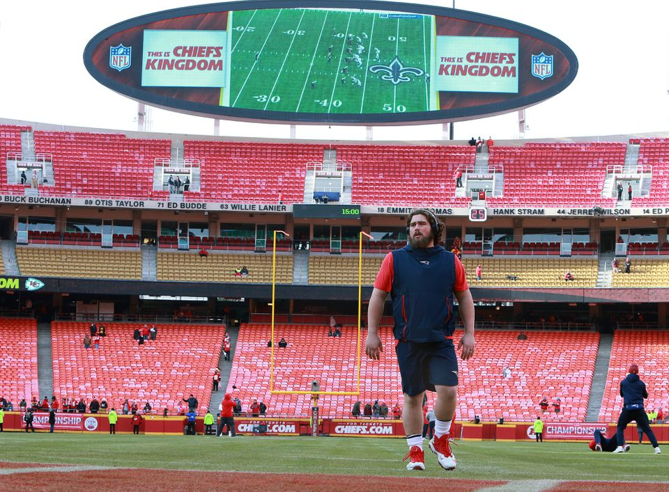 Before the game, Patriots center David Andrews was on the field in shorts while the NFC Championship game was being shown on the screen behind him.