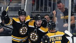 After scoring in the first game of the season, the Bruins' Jake DeBrusk (center) enthusiastically celebrated: knee down, half-windmill, pounding the glass — a staple of his game.