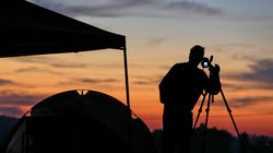 Jim Cleveland, of Shelbyville, Ky., set up a camera at his campsite at sunrise as he prepared for the last solar eclipse on Aug. 21, 2017. This year, the solar eclipse will reach its peak at 5:33 a.m.