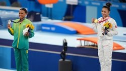Gold medal winner Sunisa Lee of the United States, right, and silver medalist Rebeca Andrade of Brazil during the medal ceremony for the women's all-around gymnastics competition at the Tokyo Olympics Thursday. Lee is next scheduled to compete Sunday in the uneven bars final and on Tuesday in the balance beam final.