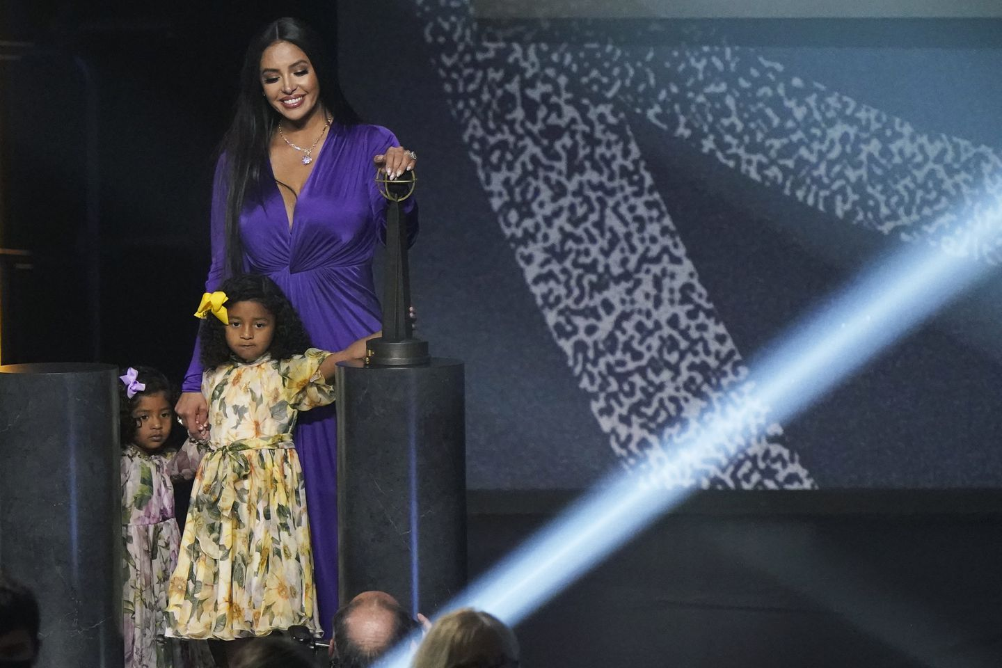 Vanessa Bryant held the hands of her daughters, Capri and Bianka, as she left the stage Saturday.