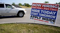 A hiring sign shown in Vernon Hills, Ill., on June 11. Barely more than a year after the coronavirus caused the steepest economic fall and job losses on record, the speed of the rebound has been so unexpectedly swift that many companies can't fill jobs or acquire enough supplies to meet a pent-up burst of customer demand.