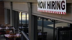 """A """"Now Hiring"""" sign stands outside a restaurant in Virginia on August 12."""