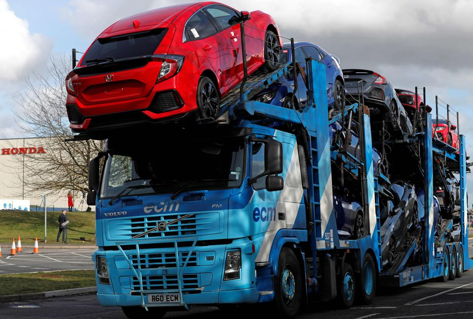 A car transporter loaded with new Honda vehicles being driven out of the Honda manufacturing plant in Swindon, southwest England, on Tuesday, the same day Honda announced it would shut the major plant, putting 3,500 jobs at risk.