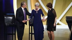 Barbara Stevens (center) shakes hands with presenters Geno Auriemma and Muffet McGraw during the the Basketball Hall of Fame enshrinement ceremony on Saturday.