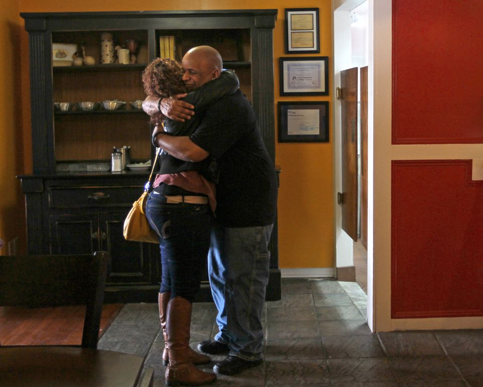 Ivette Amparo of Worcester greeted Reyman Ortiz, a waiter at Cafe Reyes, a Cuban restaurant that opened on Jan. 19 in Worcester that employs former addicts in order to help them gain vocational skills.