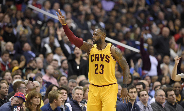 b21994ea6623 LeBron James  spectacular shot highlights Cavs  win - The Boston Globe