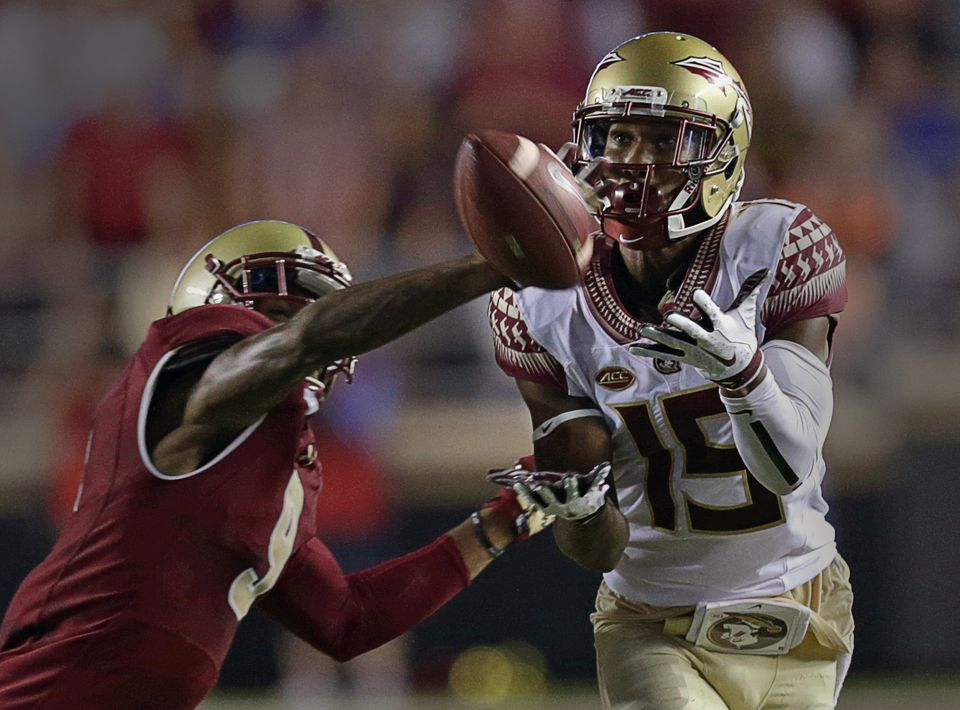 BC defensive back John Johnson (left) breaks up a pass intended for Florida State wide receiver Travis Rudolph during the second half Friday night.