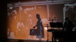 """""""ELLIS,"""" an immersive performance by Guerilla Opera chronicling the stories of some immigrants who passed through Ellis Island, incorporates historical footage into the show."""
