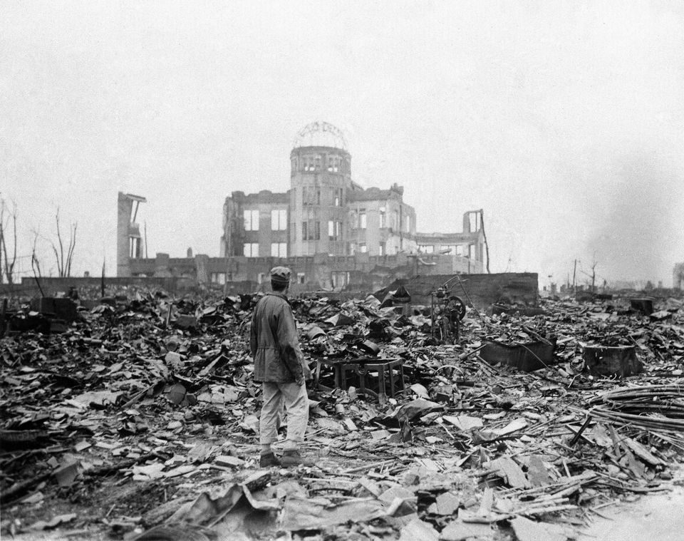 An allied correspondent stood in the rubble of a movie theater in Hiroshima, Japan, a month after an atomic bomb was dropped by American forces on the city. (AP Photo/Stanley Troutman, File)