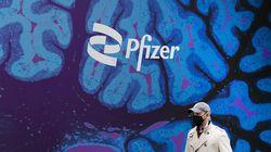 A man walks by Pfizer headquarters in New York.