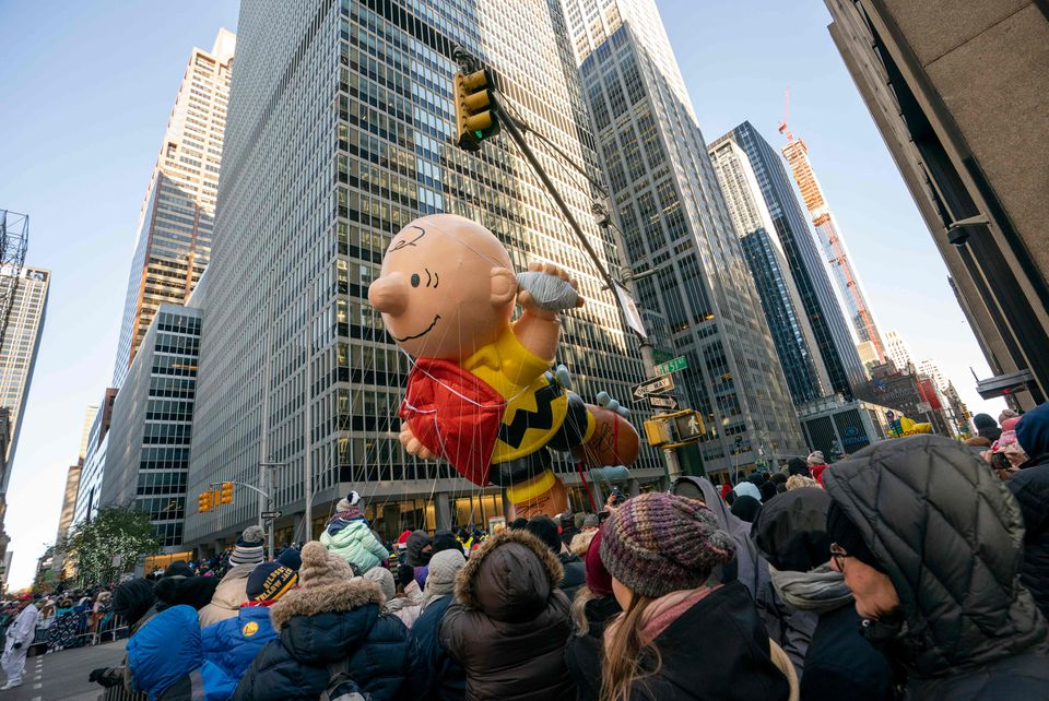 A Charlie Brown balloon floated over the crowd during the 92nd Annual Macy's Thanksgiving Day Parade.