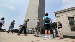 At the Bunker Hill Monument, Ron Ridley (right), a volunteer with the National Park Service, explained to visitors that the monument is closed.