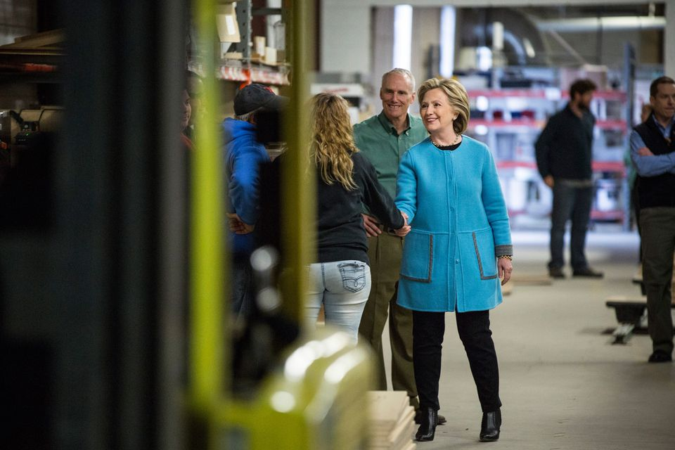 Democractic presidential candidate Hillary Clinton has been praised by stylists for adding long jackets and bold colors to her wardrobe choice.