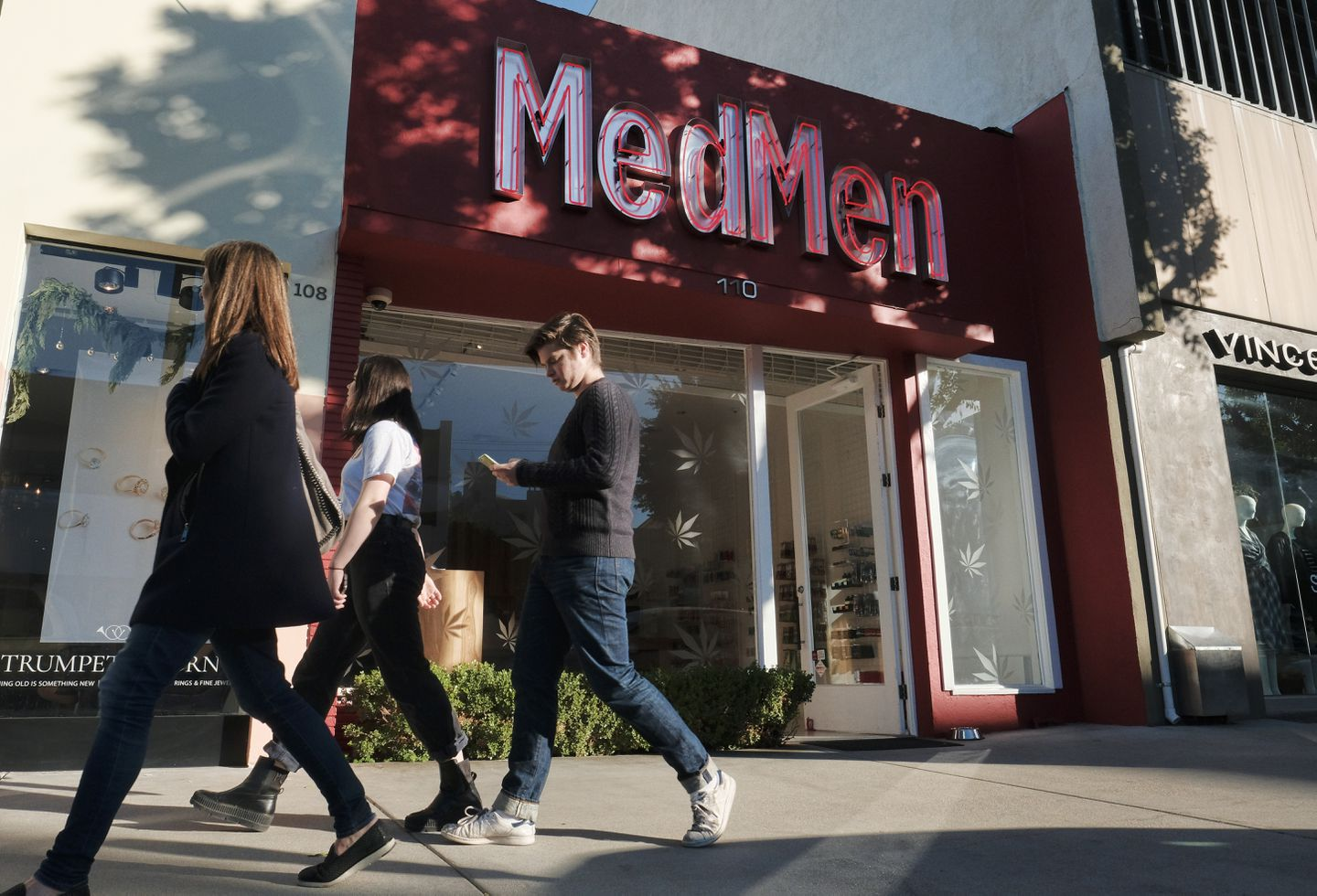 Pedestrians walked past one of the MedMen marijuana dispensaries in Los Angeles.