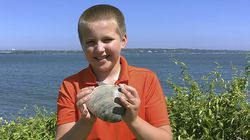 Cooper Monaco held a large quahog he found while clamming with his grandfather in Westerly, R.I.
