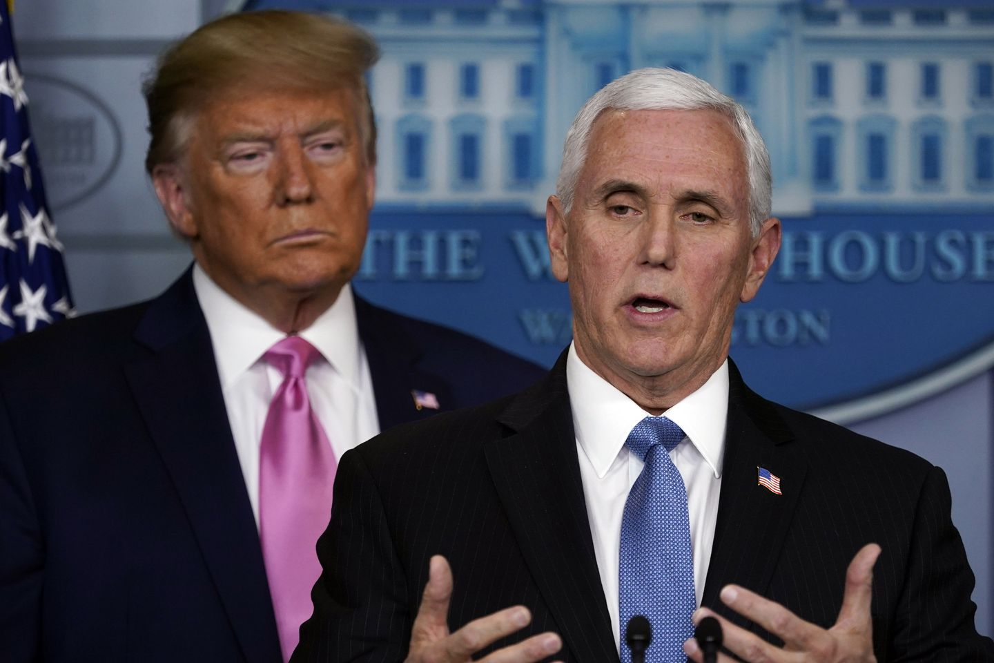 Vice President Mike Pence spoke as President Trump listened during a news conference about the coronavirus on Wednesday.