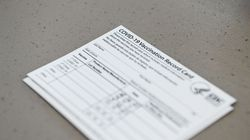A Covid-19 vaccine record card is seen at Florida Memorial University Vaccination Site in Miami Gardens, Florida on April 14, 2021.