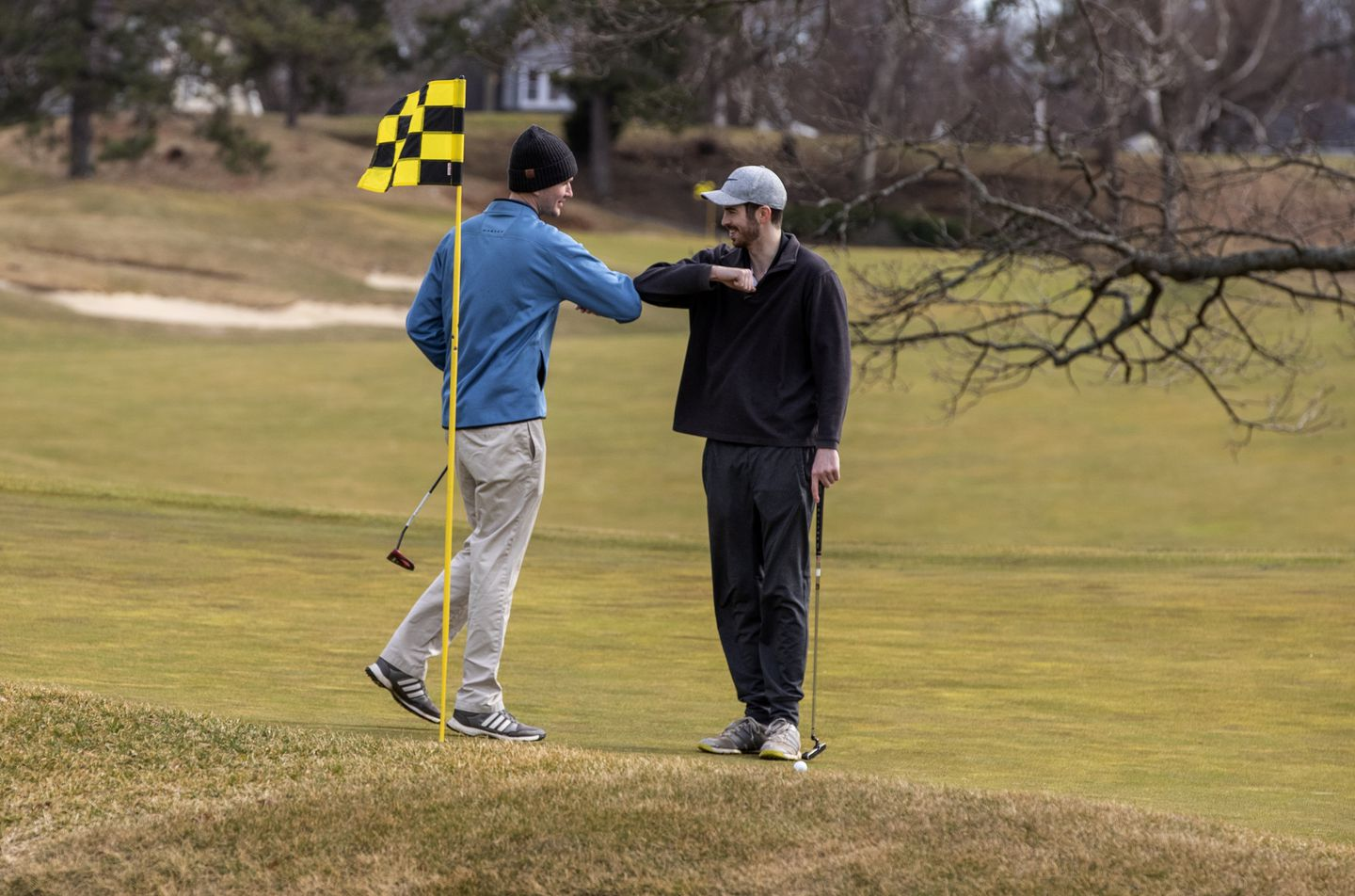 Tee times sold out at Presidents Golf Course on Saturday, where two golfers avoided more traditional high-fives in favor of elbow knocks.