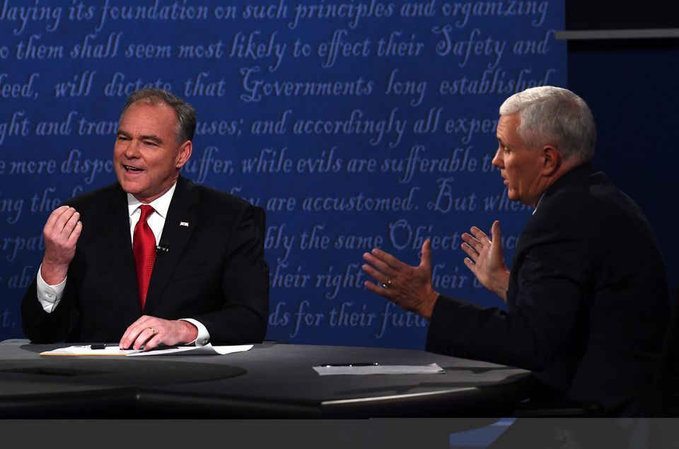 Democrat Tim Kaine (left) and Republican Mike Pence spoke during Tuesday's debate for vice presidential candidates in Farmville, Va.