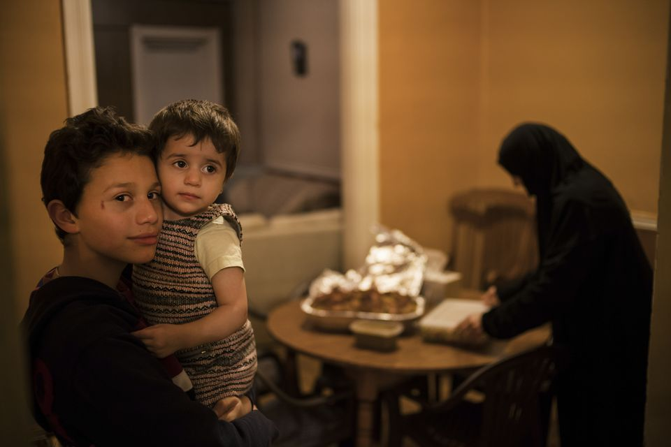 In December, a Syrian refugee family in Lancaster, Pennsylvania, prepared a meal for another family about to arrive.