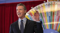 California Governor Gavin Newsom held up a lottery ball at the California Lottery Headquarters earlier this month, while drawing numbers for California's new vaccine incentive program. Massachusetts is joining California, Ohio and other states in trying a vaccine lottery to persuade holdouts to get their shots.