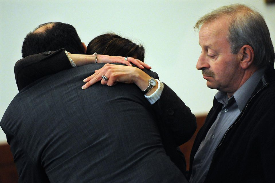 Defense attorney Keith Halpern (back to camera) hugs Lee Chiero's sister after Chiero was found not guilty by reason of insanity.