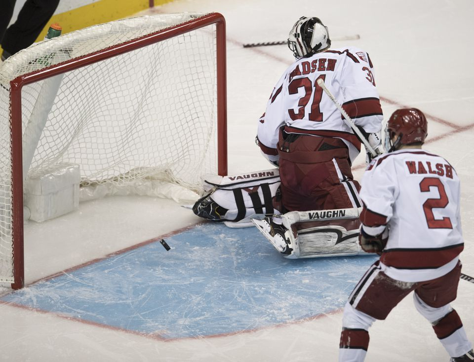 Harvard goalie Merrick Madsen couldn't stop Ty Amonte's short-side shot, which won the Beanpot semifinal for BU in the second overtime Monday night.