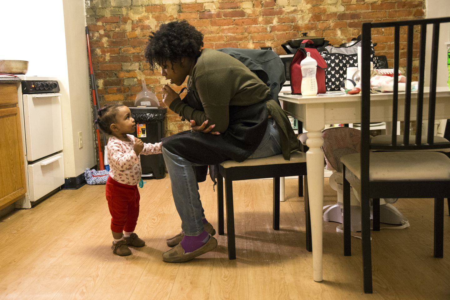 Shynnah Monge-Cueto played with her 1-year-old daughter Lyannah Cueto at their home in Boston.