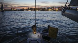 Dave Galdo looked across Boston Harbor while sailing his 50-foot boat, Restless, last week. Soon, he hopes for vistas of boundless ocean.