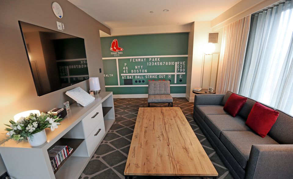 The 660-square-foot room features the #6 from the scoreboard, vintage baseball cards, and other Red Sox collectibles.