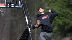 North Andover High School pitcher Brendan Holland practiced throwing with his father in the family's yard.