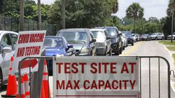 Signage was ready in case COVID-19 testing at Barnett Park reached capacity, as cars waited in line in Orlando, Fla., on Thursday.