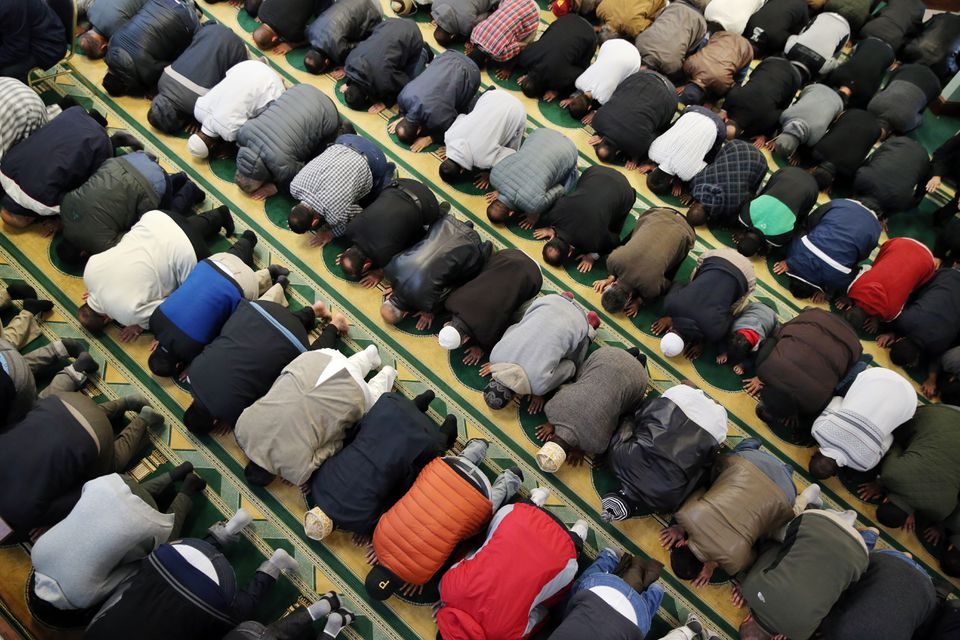 Men took part in the Friday afternoon prayer at the Islamic Society of Greater Worcester. The mosque's plans to build a Muslim cemetery in Dudley has run into opposition.