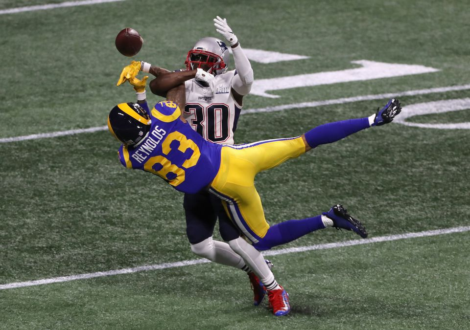 Patriots cornerback Jason McCourty breaks up a pass intended for Rams wide receiver Josh Reynolds during the second quarter.